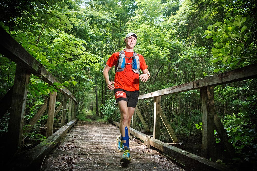 Nathan Dewey running the Hell Hole Hundred in the  Francis Marion National Forest.